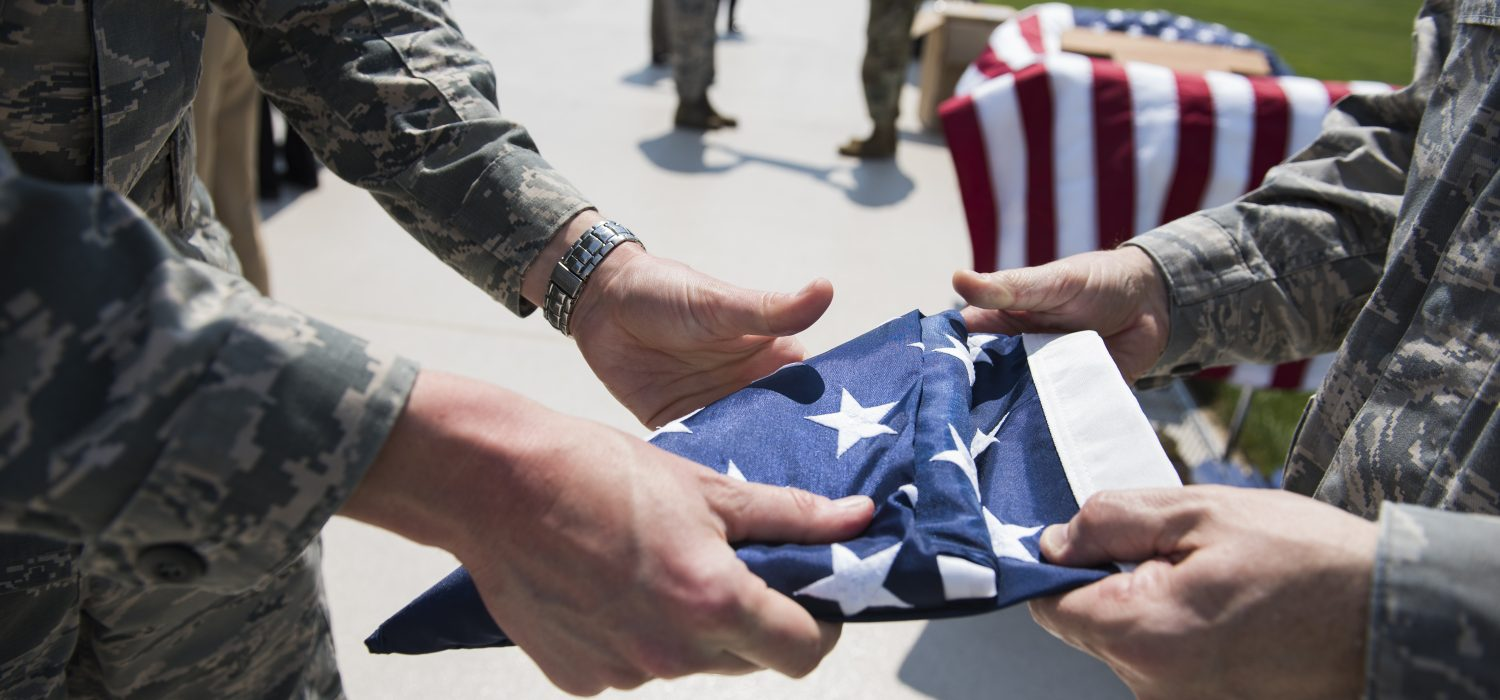 U.S. Air Force Maj. Andrew Nye, left, and Maj. James Hogan fold an American Flag in honor of Memorial Day outside of the Pentagon, May 25, 2016. (U.S. Air Force Photo by Staff Sgt. Alyssa Gibson/Released)